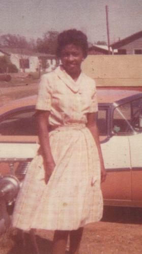 Cynthia Jones with red and white car