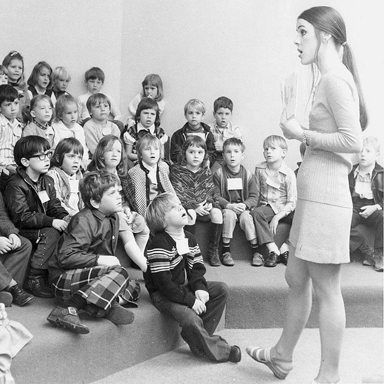 Librarian speaking to children